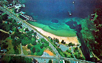 Aerial view of Weirs Beach and Lakeside Ave in the 1960s